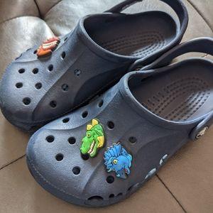 Crocs navy blue with dinosaur jibbitz